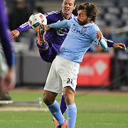 Andrea Pirlo, (front), NYCFC, is challenged by Adrian Winter, Orlando, during the New York City FC Vs Orlando City, MSL regular season football match at Yankee Stadium, The Bronx, New York,  USA. 18th March 2016. Photo Tim Clayton