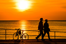 ©Licensed to London News Pictures. 13/095/2019. Aberystwyth UK. A glorious golden sunset over the waters of Cardigan Bay at Aberystwyth bringing to an end a day pf unbroken warm spring sunshine as a high pressure system dominates the weather over the whole of the UK .<br /> Photo credit Keith Morris/LNP