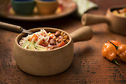 Chili by Rodney Bedsole, a food photographer based in Nashville and New York City. A bowl of chili with habaneros on the side.