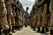 A drill instructor inspects his platoon as they prepare to march out.  Marine Corps Recruit Depot at Parris Island in South Carolina is where all male recruits living east of the Mississippi River and all female recruits from all over the US receive their arduous twelve week training in their quest to become marines. Even though there are two current active wars and a weak economy, recruitment has not been effected.  Actually, recruiting numbers have increased, with more young men and women looking toward the military for answers.
