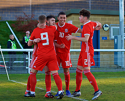 BANGOR, WALES - Saturday, November 17, 2018: Wales' Joseph Adams (2nd L) celebrates scoring the first goal with team-mates Daniel Griffiths (L), Brennan Johnson (2nd R) and Neco Williams (R) during the UEFA Under-19 Championship 2019 Qualifying Group 4 match between Sweden and Wales at the Nantporth Stadium. (Pic by Paul Greenwood/Propaganda)