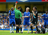 Photograph: Scott Heavey.<br />Chelsea v Leicester City, from Stamford Bridge. 23/08/2003.<br />Geremi sees red.
