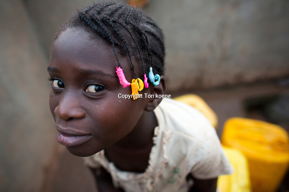 girls at a waterwell in central african republic
