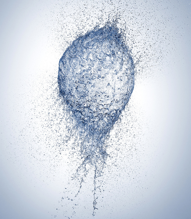 Bursting balloon filled with water.
