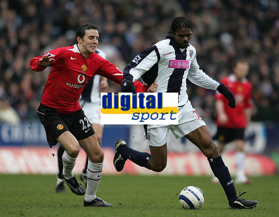 Photo: Lee Earle.<br /> West Bromwich Albion v Manchester United. The Barclays Premiership. 18/03/2006. Albion's Kanu (R) battles with John O'Shea.