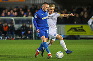 AFC Wimbledon midfielder Dylan Connolly (16) passing the ball during the EFL Sky Bet League 1 match between AFC Wimbledon and Peterborough United at the Cherry Red Records Stadium, Kingston, England on 12 March 2019.