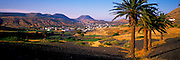 SPAIN, CANARY ISLANDS, LANZAROTE the village and palm grove of La Haria surrounded by volcanic cones at the north end of the island