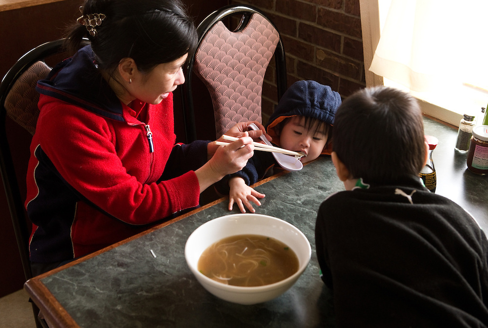 Ngoc Chau feeds her children Alynna and Alan during lunch Tuesday at the Noodle House - A Vietnamese Restaurant. The restaurant is owned by  Vietnam natives Quang Nghiem and Ngoc Chau who prepare all of the dishes fresh from scratch. (Independent/Matt Dixon)