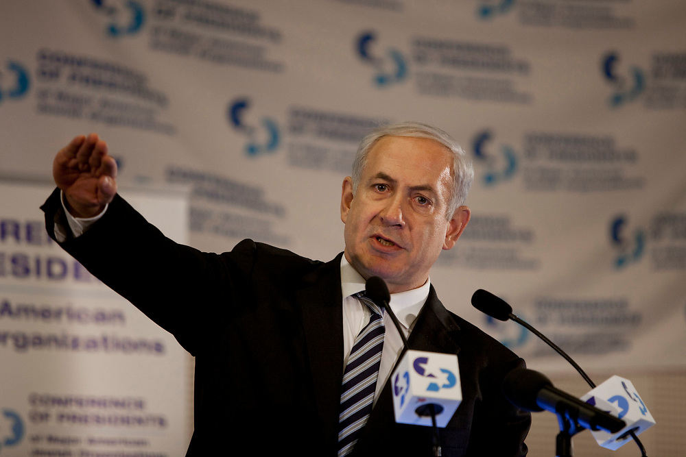 Israel's Prime Minister Benjamin Netanyahu gestures as he delivers a speech during the opening session of the Conference of Presidents of Major American Jewish Organizations in Jerusalem, on February 19 ,2012.