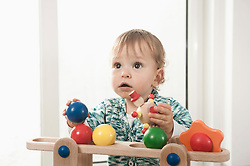 Baby girl toy wooden playing fun portrait