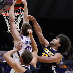 December 15, 2011; Baton Rouge, LA; LSU Tigers center Justin Hamilton (41) dunks over UC Irvine Anteaters forward Adam Folker (20) and guard Michael Wilder (23)during the second half of a game at the Pete Maravich Assembly Center. LSU defeated UC Irvine 66-59.  Mandatory Credit: Derick E. Hingle-US PRESSWIRE