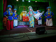 26 AUGUST 2018 - GEORGE TOWN, PENANG, MALAYSIA: A Hokkien style Chinese opera is performed on the Lim Jetty in George Town for the Hungry Ghost Festival. The opera troupe came to George Town from Fujian province in China. The Hungry Ghost Festival is a traditional Buddhist and Taoist festival held in Chinese communities throughout Asia. The Ghost Festival, also called Ghost Day, is on the 15th night of the seventh month (25 August in 2018). During the Hungry Ghost Festival, the deceased are believed to visit the living. In many Chinese communities, there are Chinese operas and puppet shows and elaborate banquets are staged to appease the ghosts.     PHOTO BY JACK KURTZ