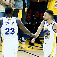 04 June 2017: Golden State Warriors forward Draymond Green (23) celebrates with Golden State Warriors guard Stephen Curry (30) during the Golden State Warriors 132-113 victory over the Cleveland Cavaliers, in game 2 of the 2017 NBA Finals, at the Oracle Arena, Oakland, California, USA.