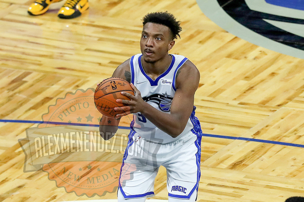 ORLANDO, FL - APRIL 12: Wendell Carter Jr. #34 of the Orlando Magic attempts a free throw against the San Antonio Spurs during the second half at Amway Center on April 12, 2021 in Orlando, Florida. NOTE TO USER: User expressly acknowledges and agrees that, by downloading and or using this photograph, User is consenting to the terms and conditions of the Getty Images License Agreement. (Photo by Alex Menendez/Getty Images)*** Local Caption *** Wendell Carter Jr.