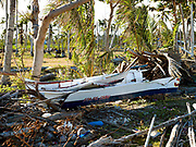 A typhoon damaged fishing boat, Talisay; Santa Fe, Bantayan Island, The Philippines. On November 6 2013 Typhoon Haiyan hit the Philippines and was one of the most powerful storms to ever make landfall. The storm had a devastating impact on the fishing and seaweed industry and caused extensive environmental damage which will have a long term impact on ecosystems and the communities who rely on them for food and employment. Three-quarters of the island's population of about 136,000 depend on fishing as their main source of income. Thousands lost their boats and equipment in the storm. Oxfam is working to support the immediate and long-term needs of affected communities on Bantayan Island including establishing boat repair stations in Bantayan.