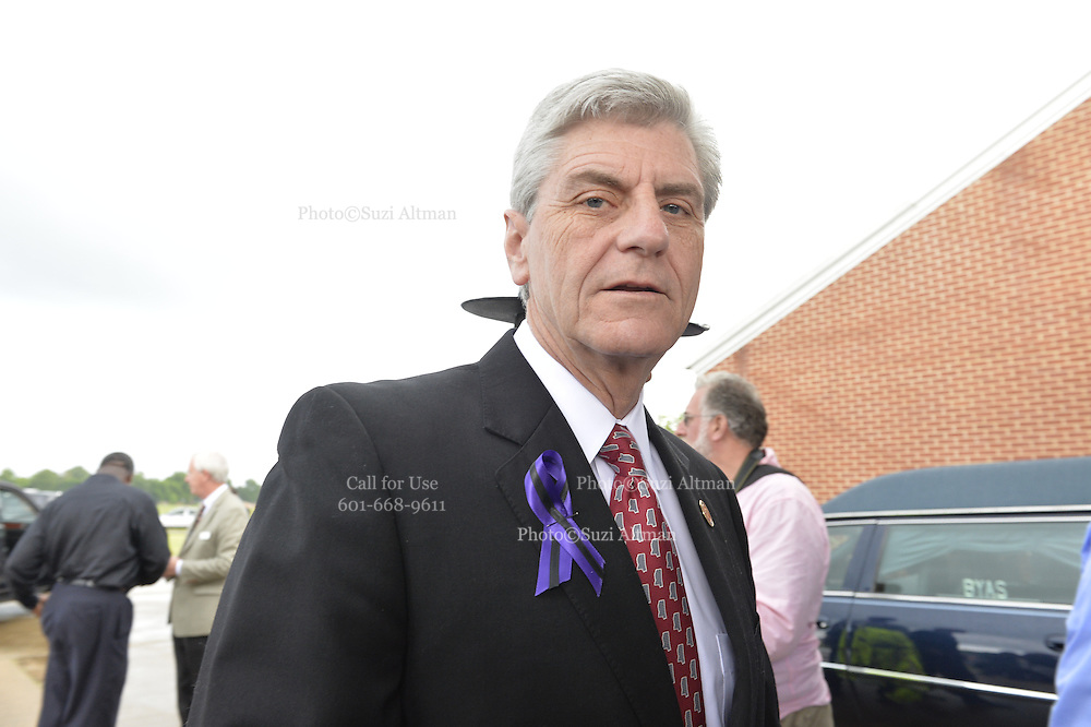 "5/30/15 Indianola   Mississippi Governor Phil Bryant arrives to B B Kings funeral at the Bell Grove Missionary Baptist Church. ""See That My Grave Is Kept Clean"" one of BB Kings famous songs forecast his funeral procession complete with two white horses and a black horse flanked with two signed Gibson guitars. Fans lined the street to see B.B. Kings final homecoming and pay their respect. Photo ©Suzi Altman"