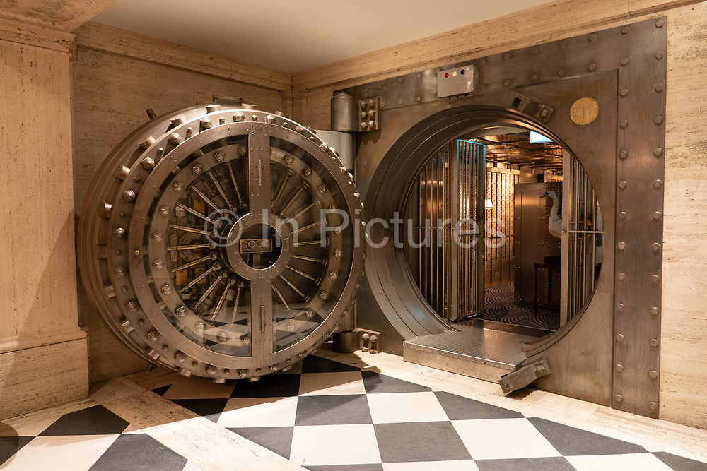 The vault bar at The Ned hotel on the 4th October 2019 in London in the United Kingdom. The Ned is a luxury hotel and private members club in the City of London. The location is set in a former bank head quarters designed in 1924 by Sir Edwyn Lutyens.