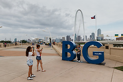 People in front of BIG sign on Continental Avenue Bridge, Dallas, Texas, USA