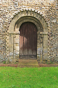 Norman style external doorway entrance, Saint Andrew church, Westhall, Suffolk, England, UK