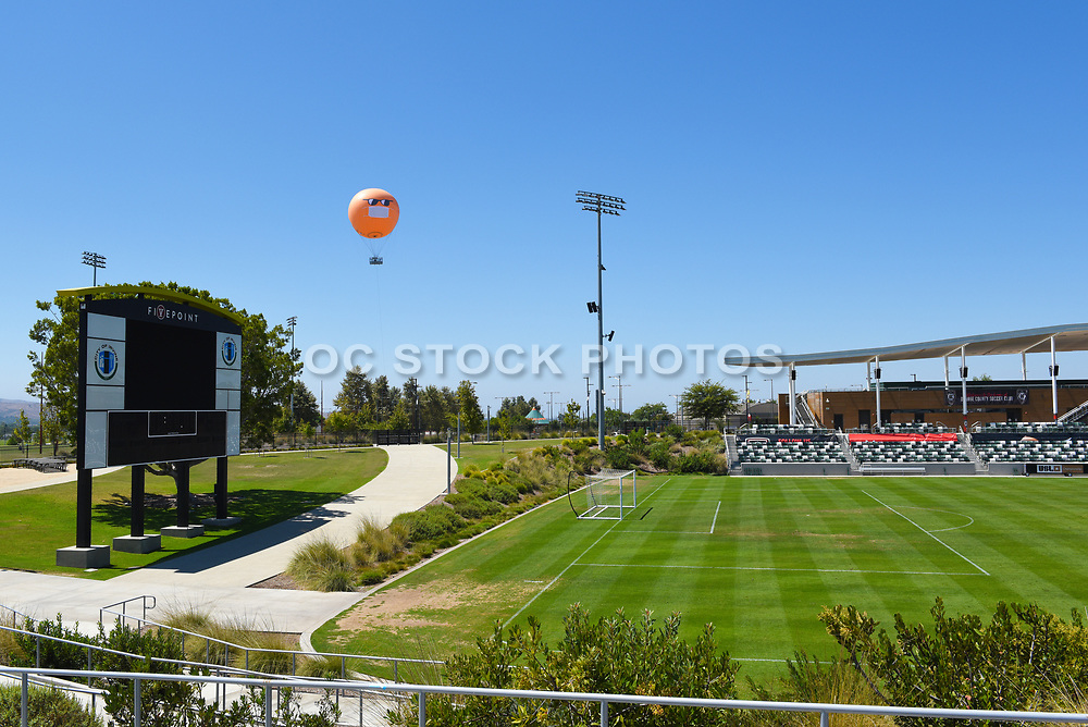 The Orange County Great Park Balloon Watching Over the Soccer Stadium With Covid Mask On