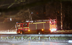Bramshott,Surrey  Saturday 26th March 2016 A Family  have  escaped to tell the tale after  their  car ploughed  into high voltage Power Cables on a major truck road this evening.<br /> The incident unfolded on the Northbound section of the A3 earlier this evening(Saturday)   The cable  that was carrying 11,000 Volt was blown down by storm force winds into the live traffic lanes of the busy A3  near Bramshott Chase in Surrey.  The vehicle that contained a family hit the cable and a second vehicle  traveling close behind  than rear ended  vehicle causing their car to flip on to its roof  and roll down in  gully.  The driver escaped without serious injury. A young child hat was in the same vehicle  was taken to hospital with a suspect broken arm and  other injuries.   The incident closed both carriageways of the A3  whilst Emergency services from Surrey and Hampshire fire and rescue service  made the  area safe.  Four car lengths  behind was a fully laden petrol tanker.  The closure created massive 3 mile  traffic  jams in and around the area whilst  many tried to seek alternative routes.<br /> Specialists from Scottish and Southern were  called in to make the power cables safe. Many home in the area have been left without power.©UKNIP