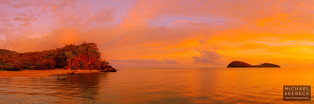 A colourful sunrise display over Double Island and the headland at Palm Cove in this panoramic photograph.<br /> <br /> Limited Edition of 125