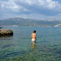 2 swimmers in the sea.<br />Beach bay,<br />Marjan Park, walk and swiming,<br />Split, Croatia. 2018