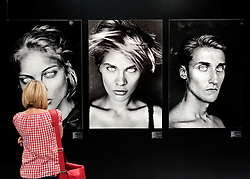 Visitor looking at   black and white display image at Leica stand at Photokina digital imaging trade show in Cologne Germany