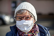 A pensioner in the age of 77 years is wearing a selfmade face mask before entering the University hospital in Frankfurt am Main.
