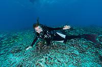 Sylvia posing on Reef under boat