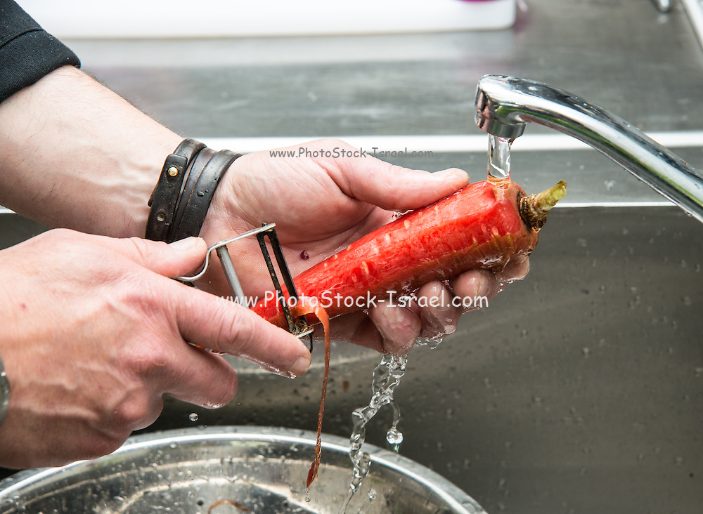 Chef prepares vegetables in a restaurant