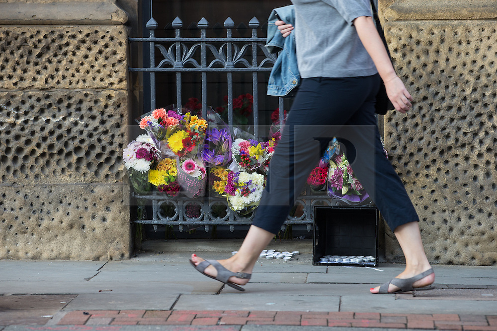 © Licensed to London News Pictures . 23/08/2015 . Manchester , UK . Flowers left at the scene on Princess Street , Manchester where , yesterday (22nd August 2015) a 26 year old motorcyclist died after hitting a wall after losing control of his Yamaha R6 . Photo credit : Joel Goodman/LNP