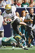 SHOT 9/4/10 2:11:53 PM - Colorado's Rodney Stewart (#5) gets tripped up while airborne by Colorado State's Elijah-Blu Smith (#22) during the second half of the Rocky Mountain Showdown at Invesco Field in Denver, Co. Colorado won the annual rivalry game 24-3. (Photo by Marc Piscotty / © 2010)