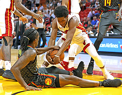 October 23, 2017 - USA - Miami Heat's Josh Richardson (0) pulls the ball away from Atlanta Hawks' Taurean Prince (12) in the first quarter at the AmericanAirline Arena Monday, Oct. 23, 2017 in Miami. The Heat won, 104-93. (Credit Image: © Charles Trainor Jr/TNS via ZUMA Wire)