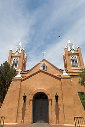 San Felipe de Neri Church is a historic Catholic church located on the north side of Old Town Plaza in Albuquerque, New Mexico. Built in 1793, it is one of the oldest surviving buildings in the city. Originally, Don Francisco Cuervo y Valdez named the church San Francisco Xavier, after the Viceroy of New Spain. Shortly afterward, The Duke of Albuquerque changed the name to San Felipe, after the King Philip of Spain.[2] San Felipe de Neri was established in 1706 under the direction of Fray Manuel Moreno and initially stood to the northwest of the Plaza. The original building was completed in 1719. The original church building collapsed in 1792 after a heavy rain and was replaced by the current structure the following year. The towers were added in 1861, a parish school was constructed in 1878, and a convent for the Sisters of Charity was built on the west side of the church in 1881. Today the church complex is undergoing extensive renovations inside and out.