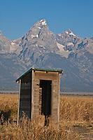 An old outhouse near the Moulton Barn on Morman Row.  Grand Teton National Park.  Wyoming, USA.