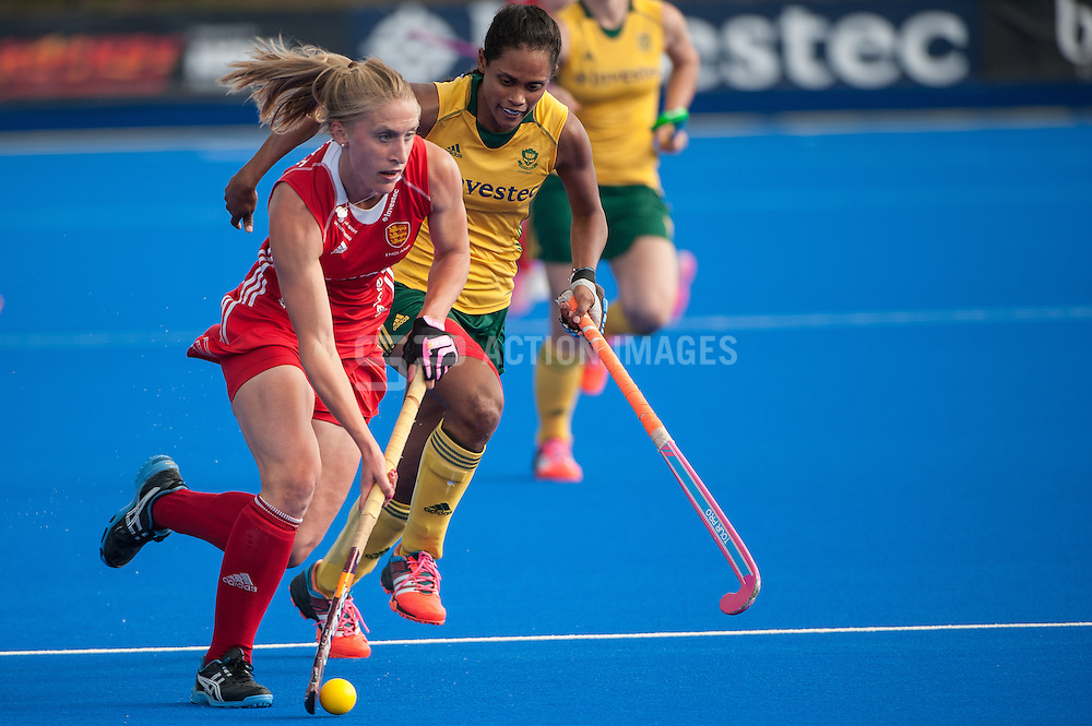 England's Susie Gilbert drives into the South African circle during the Final of the Investec London Cup. Lee Valley Hockey & Tennis Centre, London, UK on 13 July 2014. Photo: Simon Parker