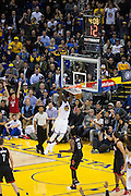 Golden State Warriors forward Draymond Green (23) dunks the ball against the Houston Rockets at Oracle Arena in Oakland, Calif., on December 1, 2016. (Stan Olszewski/Special to S.F. Examiner)