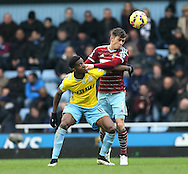 West Ham's Aaron Cresswell tussles with Crystal Palace's Wilfred Zaha <br /> <br /> Barclays Premier League - West Ham United  vs Crystal Palace  - Upton Park - England - 28th February 2015 - Picture David Klein/Sportimage