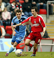 Photo: Chris Ratcliffe.<br />Leyton Orient v Wycombe Wanderers. Coca Cola League 2. 25/03/2006.<br />Craig Easton of Leyton Orient gets away from Matt Bloomfield of Wycombe