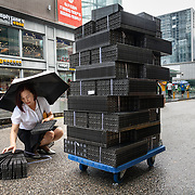 A woman transports computer parts in Shenzhen, a hightech hub in southern China.