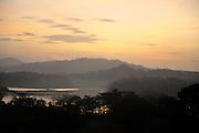 Sunrise View over Jungle Canopy & Gatun Lake, Panama, Central America, Gamboa Reserve, Parque Nacional Soberania, sunbeams through clouds