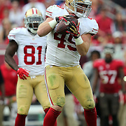 San Francisco 49ers fullback Bruce Miller (49) make a catch during an NFL football game between the San Francisco 49ers  and the Tampa Bay Buccaneers on Sunday, December 15, 2013 at Raymond James Stadium in Tampa, Florida.. (Photo/Alex Menendez)