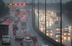 © Licensed to London News Pictures. 16/09/2016. London, UK. Morning rush hour traffic makes it's way along the M25 in heavy rain. Torrential rain is hitting parts of the United Kingdom todayb bringing an end to the recent hot spell. Photo credit: Peter Macdiarmid/LNP