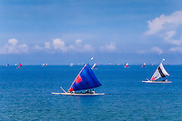Nusa Tenggara, Lombok, Senggigi. Traditional sail vessels on West Lombok returning from fishing early in the morning.