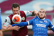 Kevin Long of Burnley (28) and Brighton and Hove Albion forward Aaron Connolly (44) contest a loose ball during the Premier League match between Burnley and Brighton and Hove Albion at Turf Moor, Burnley, England on 26 July 2020.