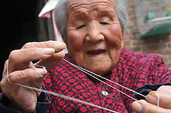 October 8, 2016 - Anyang, Anyang, China - Anyang, CHINA-October 8 2016:?(EDITORIAL?USE?ONLY.?CHINA?OUT) Ma Chunhuan, a 103-year-old woman, does housework in Siyangzhuang Village, Neihuang County, Anyang, central China¡¯s Henan Province, October 8th, 2016. Although Ma Chunhuan is 103 years old, she can do needle work flexibly and use cell phone easily. (Credit Image: © SIPA Asia via ZUMA Wire)