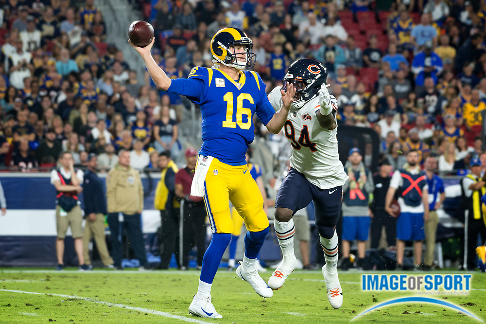 Los Angeles Rams quarterback Jared Goff (16) avoids the sack from Chicago Bears outside linebacker Leonard Floyd (94) during an NFL game on Sunday, Nov. 17, 2019, in Los Angeles. The Rams defeated the Bears 17-7. (Ed Ruvalcaba/Image of Sport)