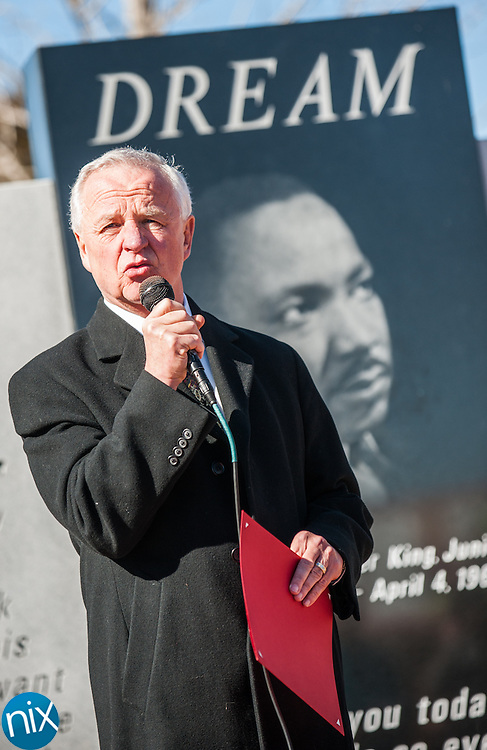 Concord Mayor Scott Padgett reads a proclamation during a wreath laying ceremony honoring the legacy of Dr. Martin Luther King Jr. at the MLK Plaza in Concord Monday afternoon.