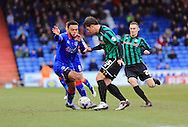 Aaron Amadi-Holloway challenged by Niall Canavan during the Sky Bet League 1 match between Oldham Athletic and Rochdale at Boundary Park, Oldham, England on 19 March 2016. Photo by Daniel Youngs.